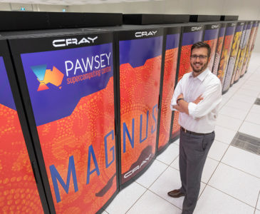 Mark Stickells, Pawsey Executive Director, standing in front of the Magnus Supercomputer